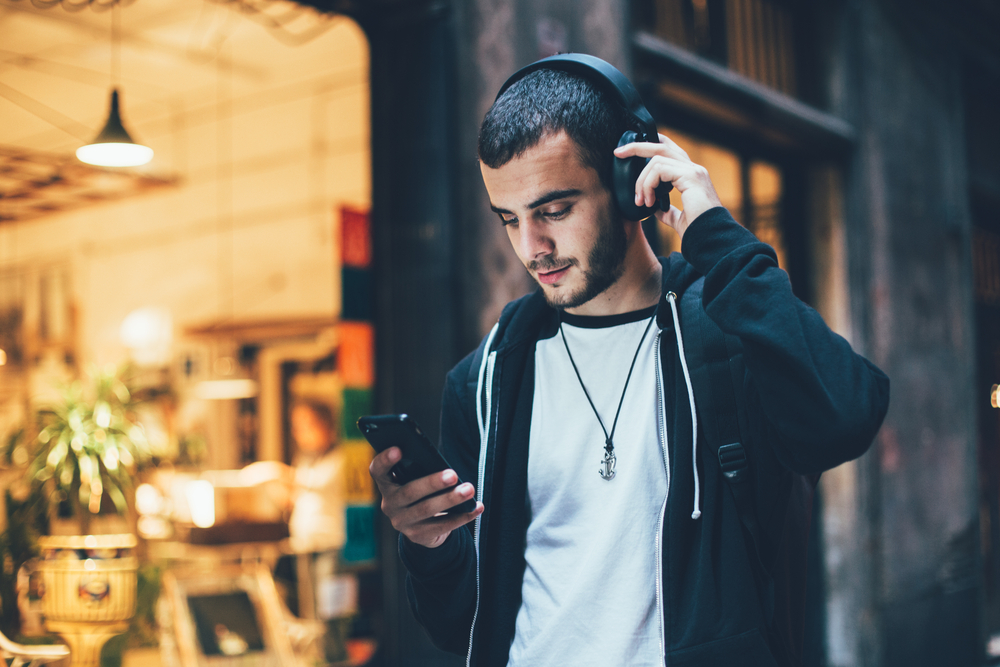 Man Listening to Music with Wireless Headphones